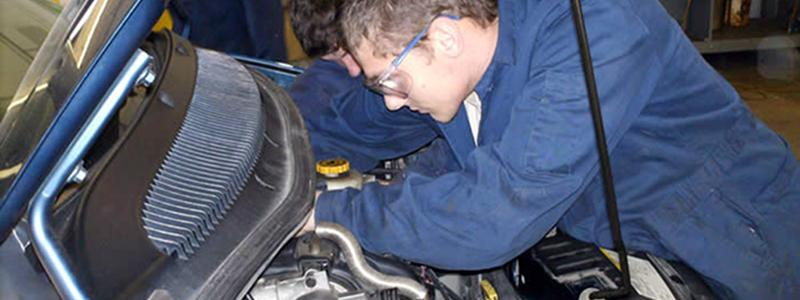 young male working on automobile at VIU Powell River Campus Auto Shop